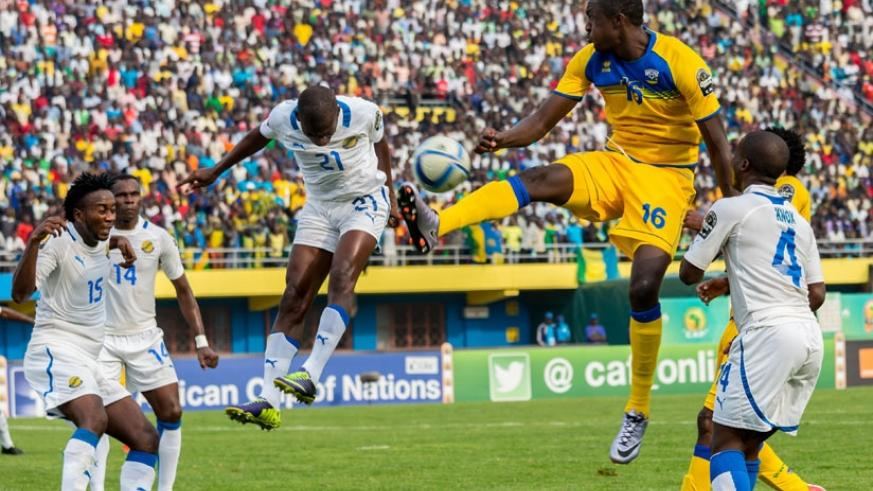 Ernest Sugira (#16) jumps to control the ball against Gabon during CHAN 2016 earlier this year. The striker is close to joining DR Congo's AS Vita Club. (File)