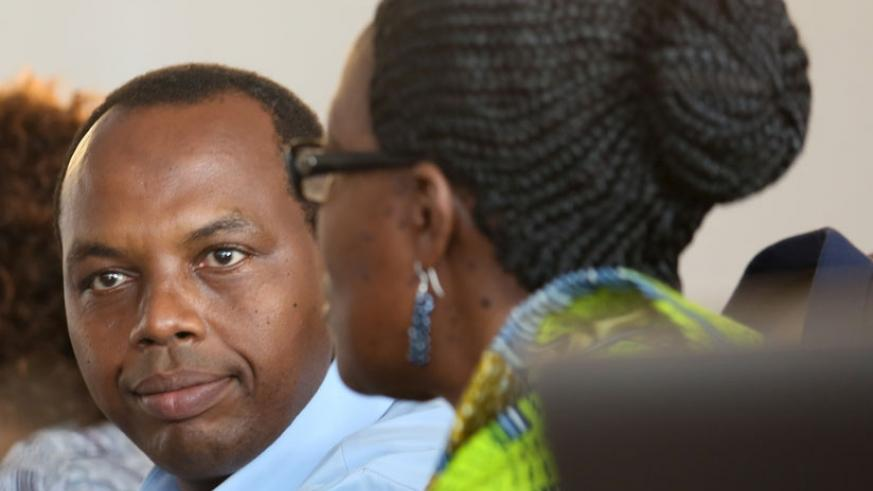 Gatare (L) listens to MP Rwaka during the session at Parliament yesterday. (Timothy Kisambira)