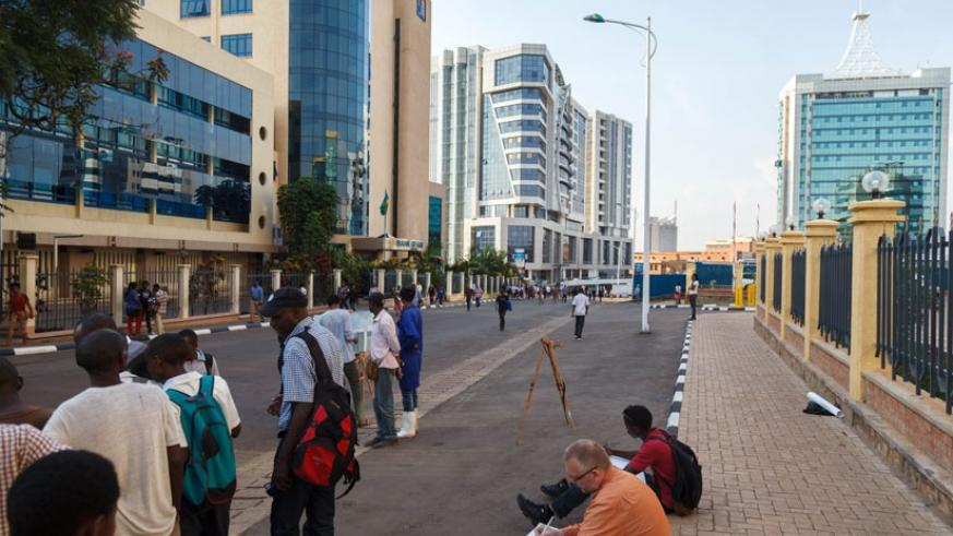 People enjoy the car-free zone introduced last year in the city centre. Some people want the City of Kigali to consult more before implementing such policies. (T. Kisambira)