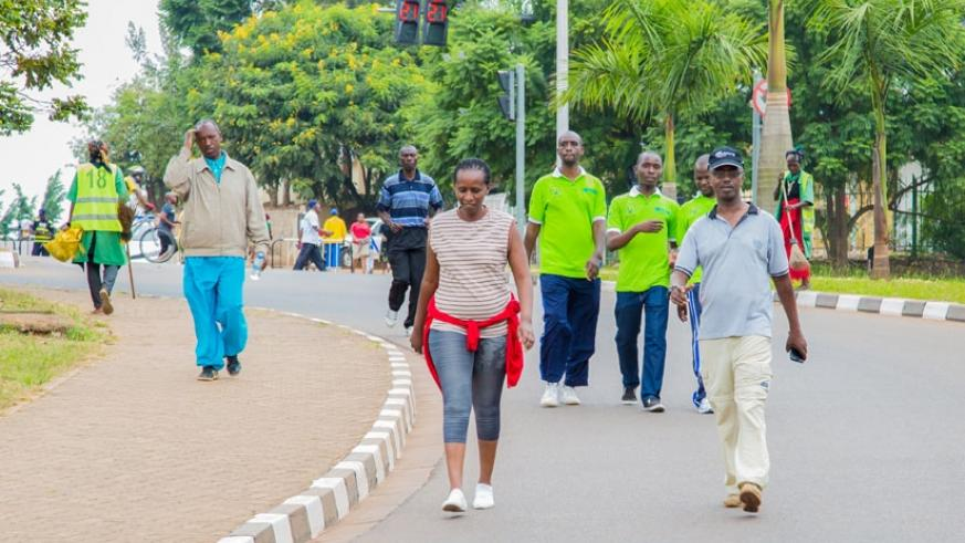 People walk on KN 5 Avenue during the Car-Free Day yesterday. Kigali city dwellers yesterday took to the maiden Car-Free Day with funfair. (Faustin Niyigena)