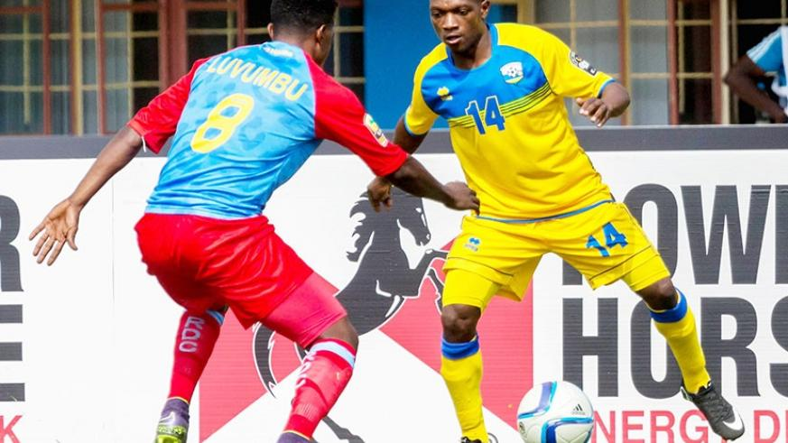 Ndayishimiye tries to go past DR Congo midfielder Heritier Luvumbu during the 2016 CHAN quarter-finals. The Amavubi left-back has joined Police FC. / Timothy Kisambira.