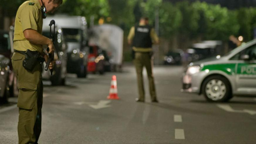 A policeman stands near the scene after a man was killed and 11 others were injured in an explosion in Franconia Ansbach. / Daniel Karmann/EPA