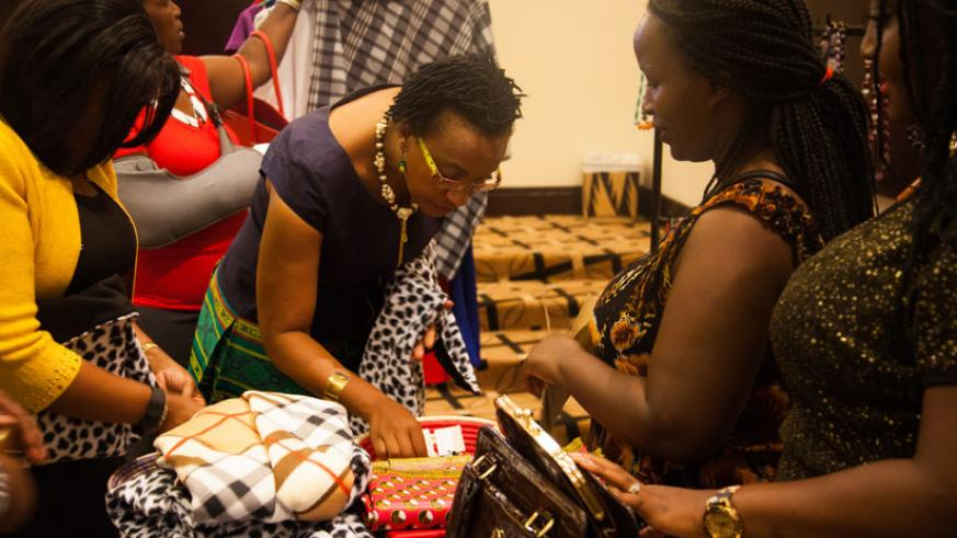 Participants admire Rwandan products at the mini-exhibition that was part of the two-day forum in Kigali. Women have been urged to form groups to lobby for their interests at regio....