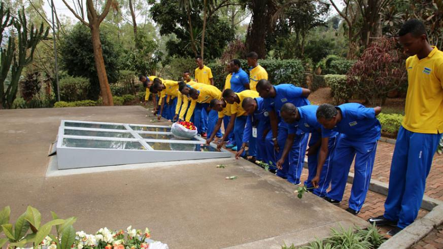 Players from Rwanda, Uganda and Angola pay respect to the victims of the 1994 Genocide against Tutsi at the the Kigali Genocide Memorial Centre. / Courtesy.