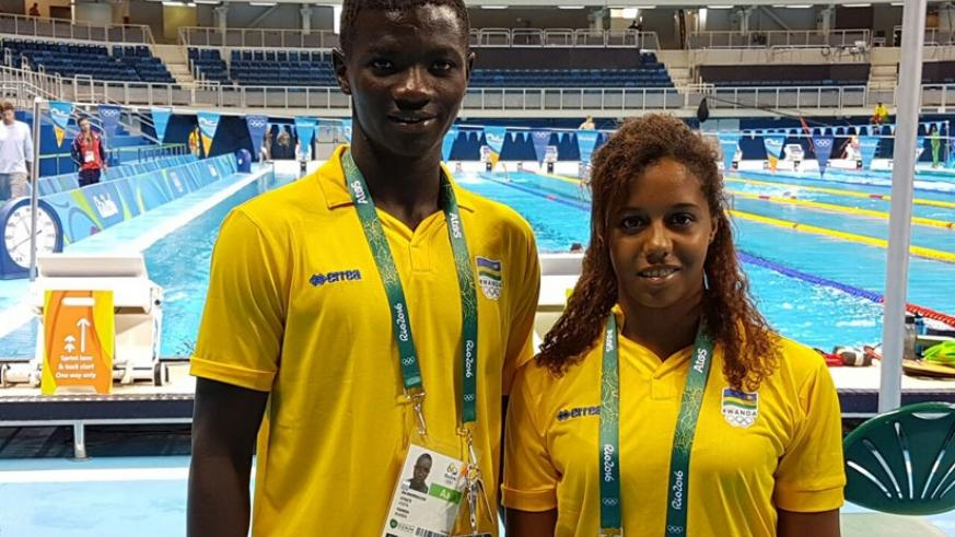 Rwandan swimmers Imaniraguha and Umurungi  pose for a photo on arriving in Rio for the Olympic Games. (Courtesy)