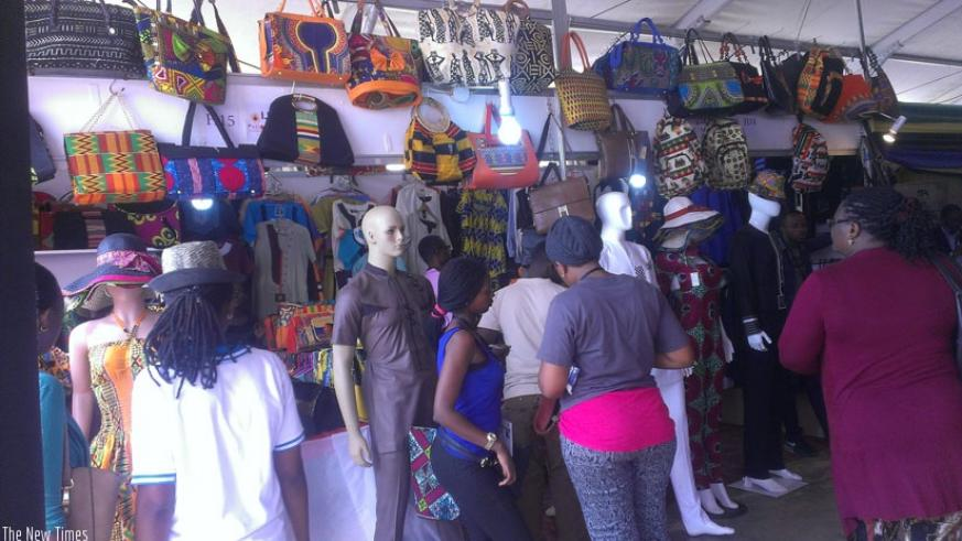 Show goers admire Rwandan made leather handbags at the ongoing expo at Gikondo Show Grounds yesterday. Such can now be exported to the US under AGOA scheme.  (Anitha Kirezi)