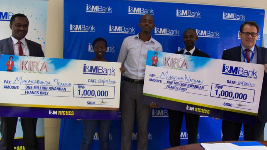 Mukakabanda (second left) and Mugisha (middle) receive dummy cheques from I&M Bank officials led by the bank's chief Bairstow (right) and Faustin Byishimo (left), the executive d....