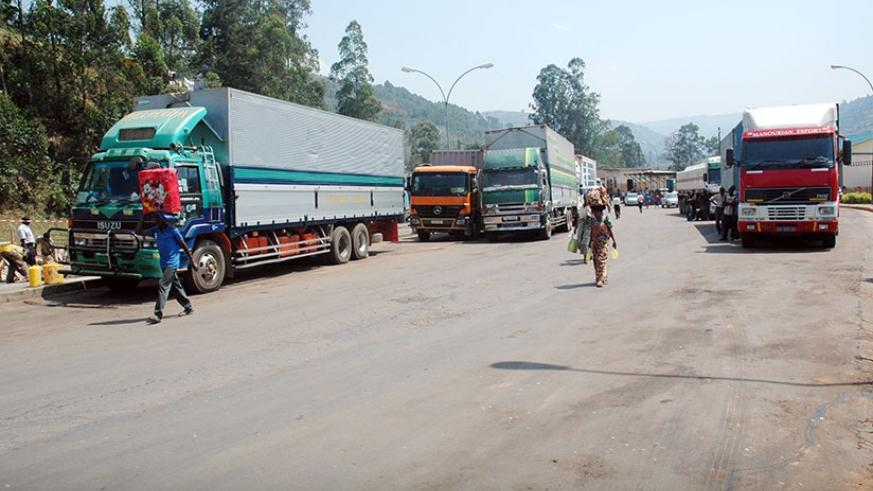 Trucks await clearance at Gatuna border post. EAC is seeking to phasing out the US Dollar as a medium of exchange in cross-border trade and instead use local currencies. / File.