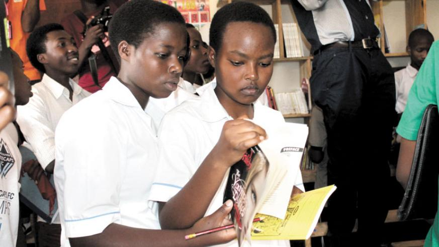 Students peruse through some of book titles at a youth library in Bugesera District. / File.