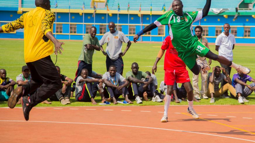 Uganda's Alworunga Chesor scores a goal against Kenya in the handball game at National Amahoro Stadium on Wednesday during the 10th East African Military games. (All photos by Faus....