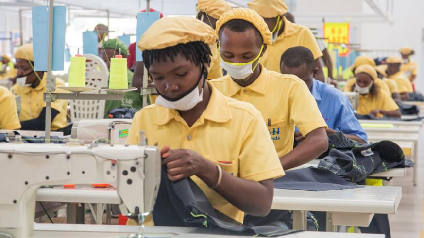 Workers at C & H Garments Ltd in Kigali's Special Economic Zone. The factory produces garments for export and local markets. / Faustin Niyigena.
