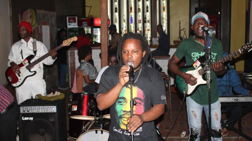2T Reggae Man doing what he likes best, singing reggae songs to an audience. / Moses Opobo.