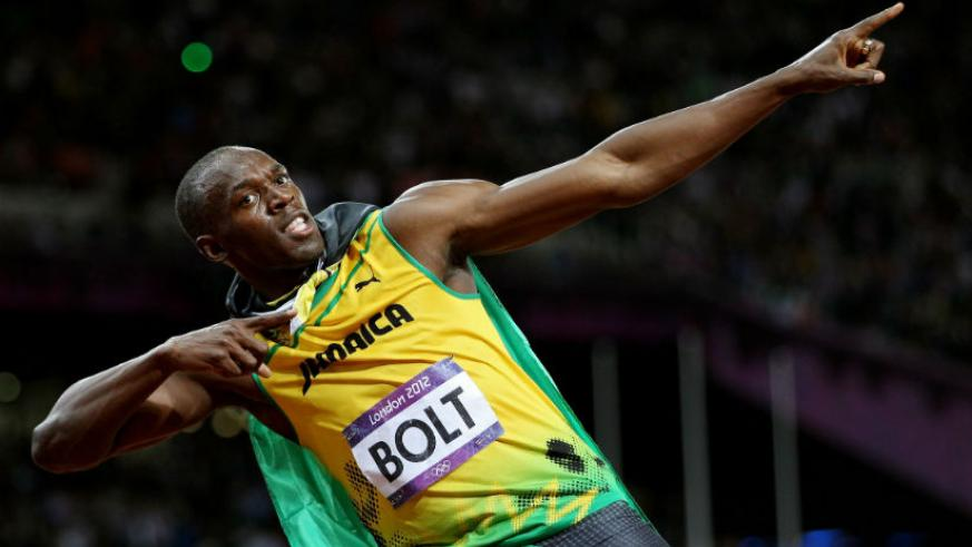 Bolt creates his trademark 'lightning bolt' pose for the cameras as he celebrates yet another Olympic success. / Internet photo.