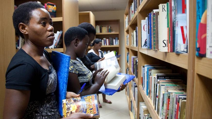Youths search for books from shelves at Kigali Public Library. / File.