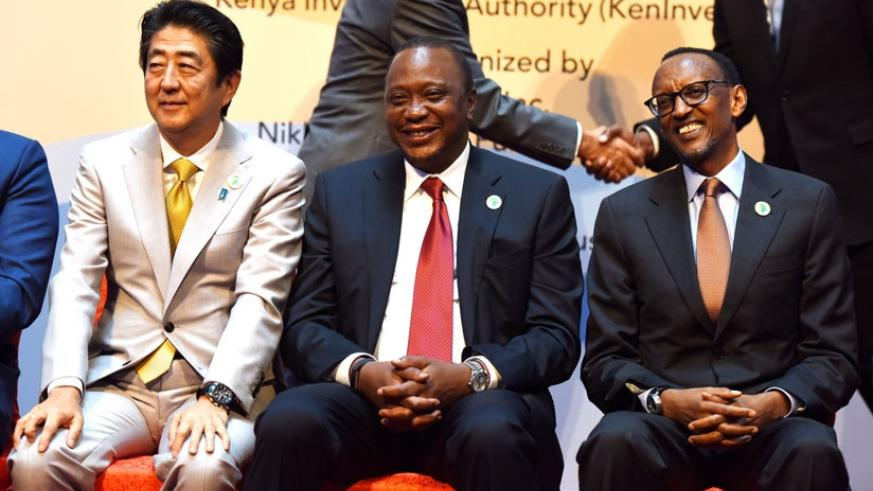 From L-R; Japanese Prime Minister Shinzo Abe, Kenyan President Uhuru Kenyatta and President Kagame at the 6th Tokyo International Conference on African Development in Nairobi, Keny....