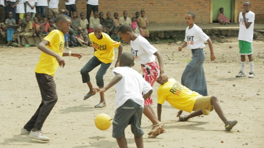 Kids play football at Kanembwe School in Rubavu District. (Net photo)