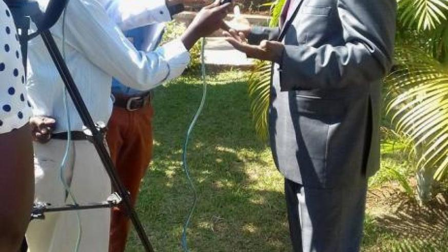 Ndayisaba answers questions from journalists on the margin of the conference on Monday. / Courtesy.