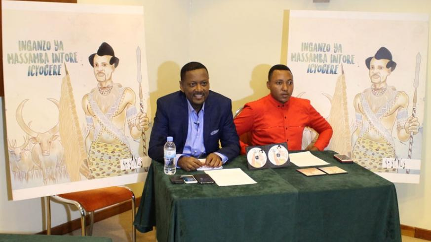 Traditional music maestro Massamba Intore (left), with Marcel Ntazinda, a member of the Gakondo group, during a press conference on Tuesday. (Julius Bizimungu)
