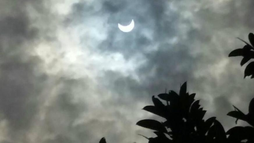 People in Kigali can currently view the unfolding partial solar eclipse, that's expected to last hours. / Courtesy