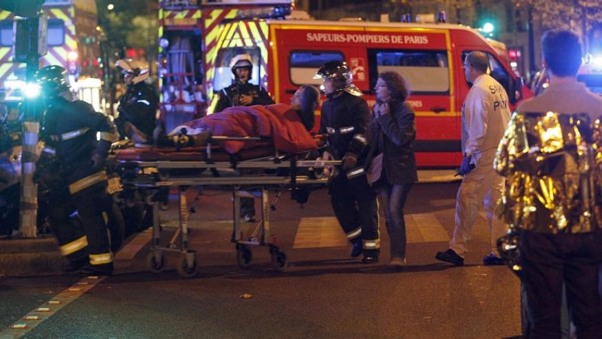 Medics move a wounded man near the Boulevard des Filles-du-Calvaire after an attack in Paris last year. (Net photo)