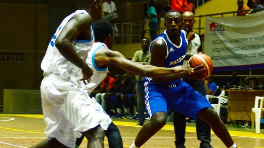 Aristide Mugabe of Patriots (R) attempts to make a pass during this year's Gisembe memorial tourney. The league winners are preparing for Zone V. / Sam Ngendahimana.