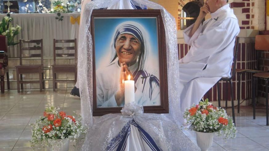 A framed photo of St Teresa stands at Sainte Famille Parish. / Remy Niyingize.