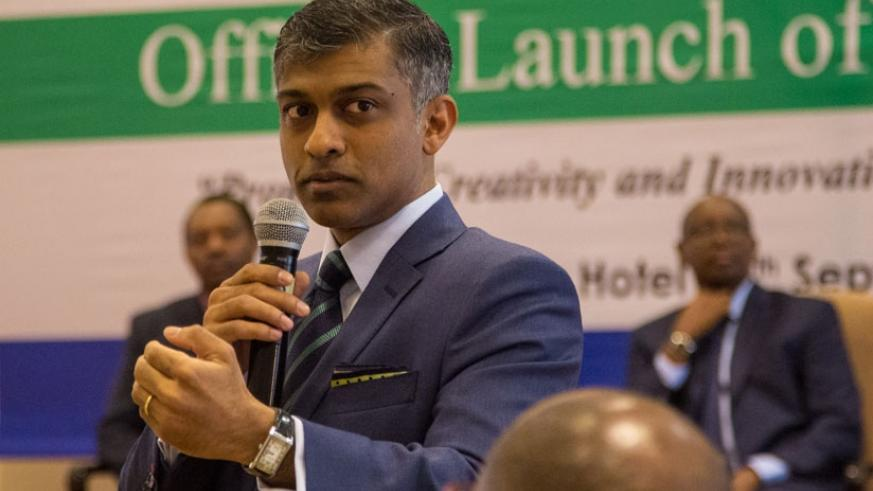Krishnada addresses the participants about the results of his company's research. (Photos by Faustin Niyigena)