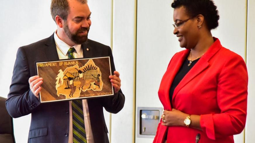 Fredrik Lundh Sammeli, a representative of Swedish parliament, receives a gift from Speaker Mukabalisa after the meeting. / Nadege Imbabazi.