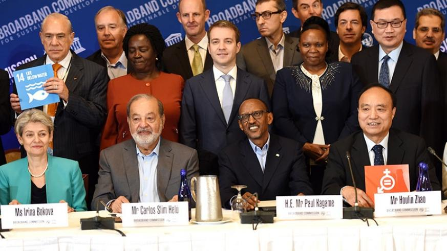 President Kagame with Carlos Slim Helu, a Mexican business magnate (left), Houlin Zhao, International Telecommunication Union Secretary-General (R), and Irina Bokova, the director-....