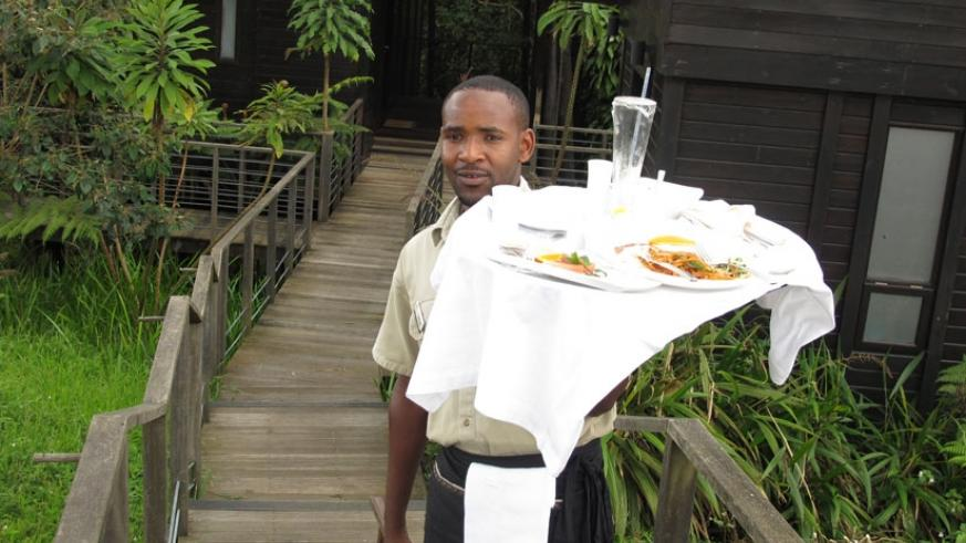 A waiter at Nyungwe Forest Lodge. The annual Customer Service Week is a time to celebrate workers and clients. (File photo.)