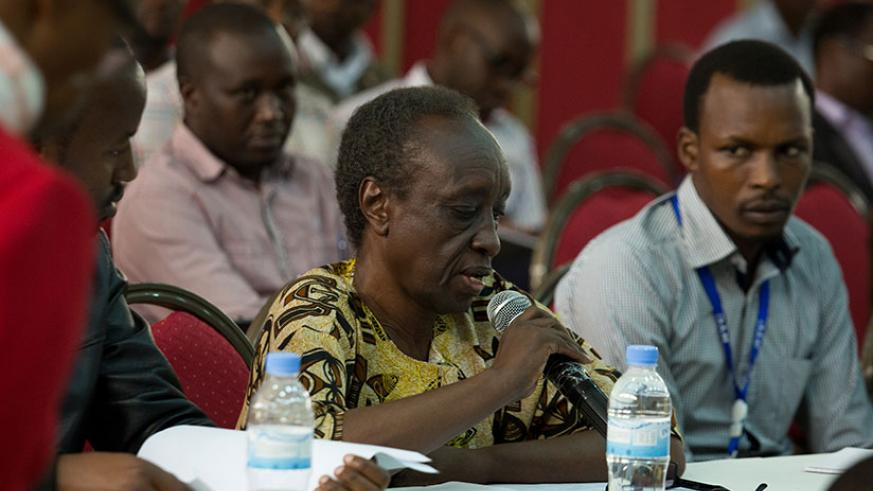 A participant reacts at a question at the workshop on Tuesday. (Photos by T. Kisambira)