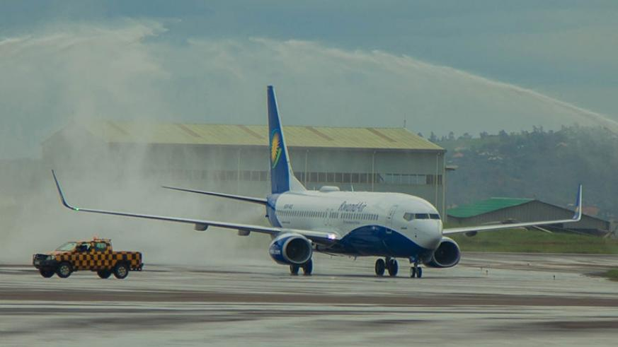Africa's first Wi-Fi-connected Boeing 737-800NG, the pride of national carrier RwandAir, is welcomed by the fireman salute at Kigali International Airport yesterday. (All photos by Nadege Imbabazi)
