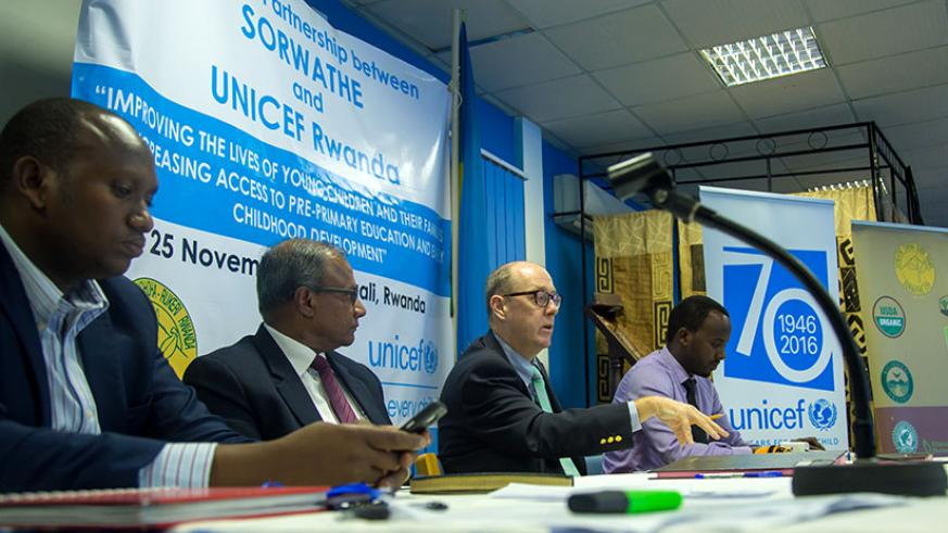 UNICEF country representative Ted Maly (second-right) gives his remarks as John Ntigengwa, the deputy director-general Imbuto Foundation (L), SORWATHE director-general Rohith Peiris (second-left), and Issa Nkurunziza, the National Agricultural Exports Development Board tea division manager, look on. / Timothy Kisambira