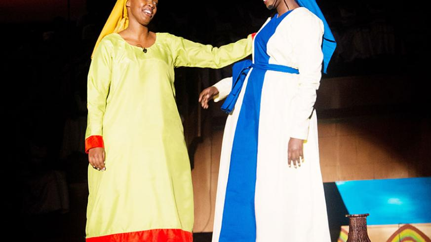 Sisters, Mary (R) and Rachel share a light moment in one of the scenes staged yesterday. (All photos by Faustin Niyigena)
