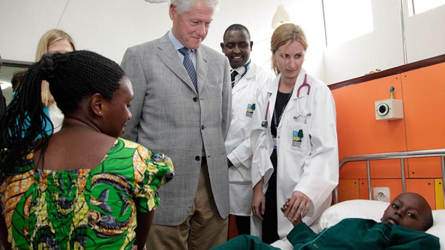 Former US President Bill Clinton tours Butaro Cancer Hospital in 2012. / File