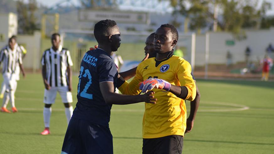 Police substitute keeper Emmanuel Bwanakweli (R), was at fault for APR's equalizer when he failed to clear a back pass. / Sam Ngendahimana