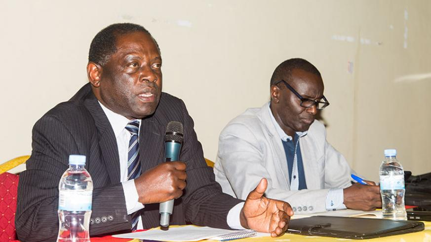 State Minister for Agriculture, Fulgence Nsengiyumva speaks during the meeting as Director for planning, Octave Semwaga looks on. / Faustin Niyigena
