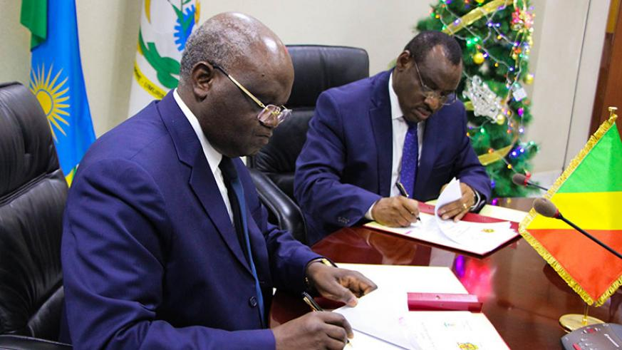 Minister of Finance Claver Gatete (R) and Minister of Labour of Congo Emile Ouosso during the signing ceremony in Kigali. / Nadege Imbabazi