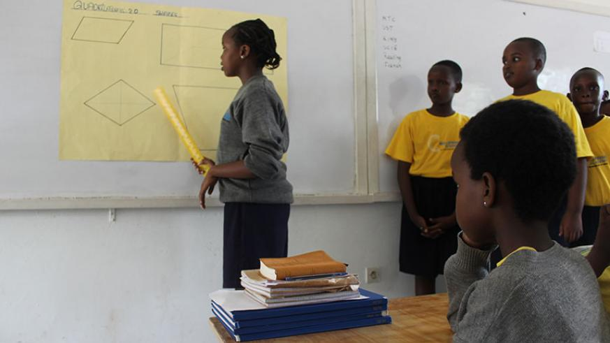 Students engage in a class activity. It takes a knowledgeable and motivated teacher to get good results learners. / Dennis Agaba