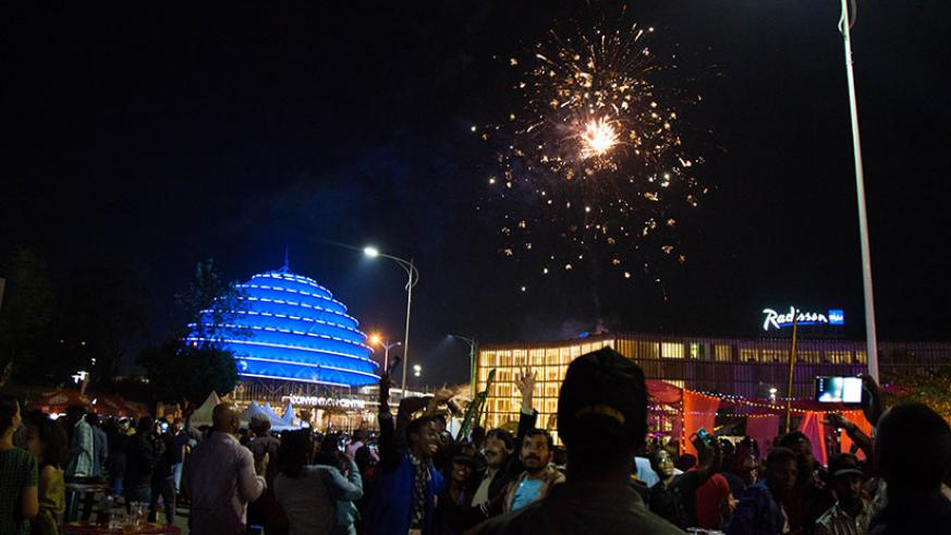Rwandans and other nationals in the country cheer as fireworks light up the skyline around Kigali Convention Centre at the clock of New Year's Day. Several clerics echoed a message....