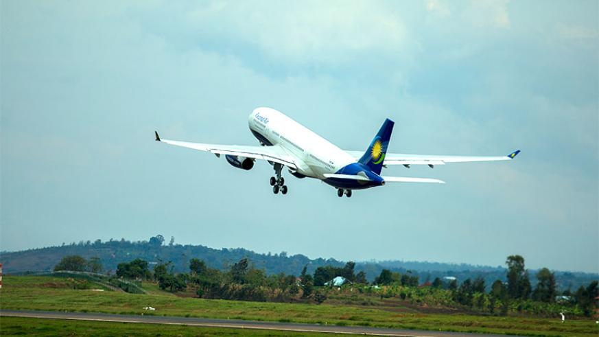One of the newly-acquired RwandAir planes takes off at Kigali International Airport. / Timothy Kisambira