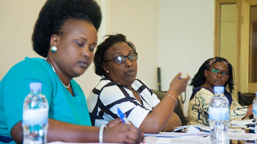 Alphonsine Mukarugema (C), Deputy Chairperson of the Social Affairs Parliamentary Committee, speaks during the meeting as Angelina Muganza (R), Executive Secretary of Public Servic....