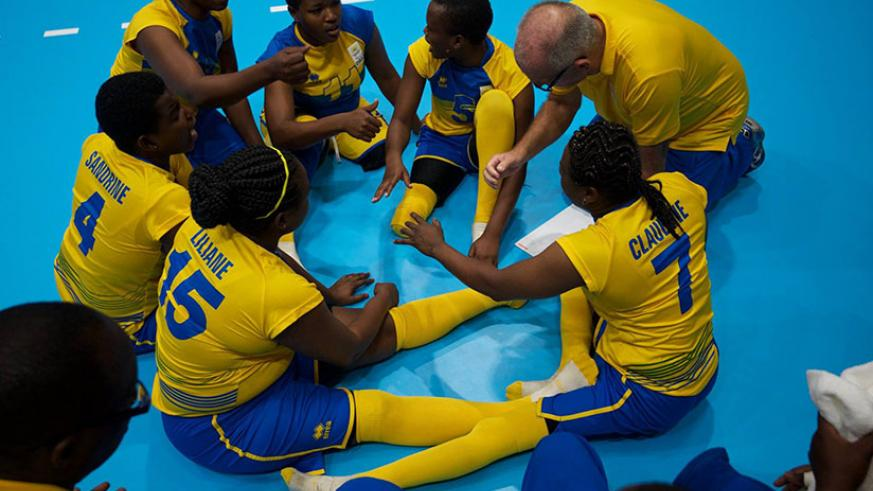 Rwanda women sitting volleyball team head coach Peter Karreman talking to his players during a game in Rio. / Courtesy