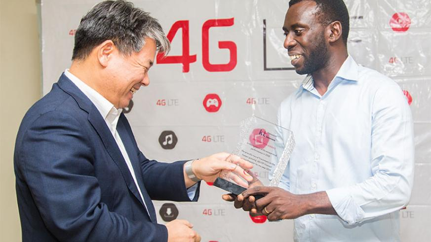 Truconnect Ltd MD, Richard Ruganintwari (R) receives an award from Korea Telecom Rwanda Networks (KTRN) CEO Han-Sung Yoon (Patrick) for being the best 4G internet provider last yea....