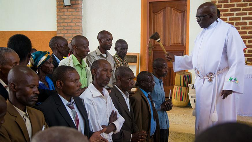 Fr Ubald Rugirangoga sprinkles spiritual water on former Genocide perpetrators who sought forgiveness at Nyamata Parish in Bugesera District yesterday. A total of 166 Catholic fait....