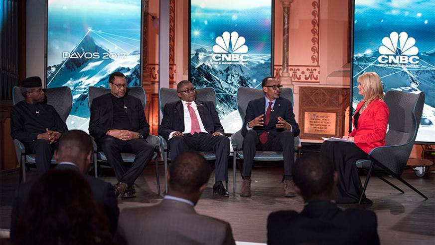 President Kagame in a panel discussion with, from left to right, Oluyemi Osinbajo,  vice-president of Nigeria; Phuthuma Nhleko, executive chairman, MTN Group; and Siyabonga Gama of....