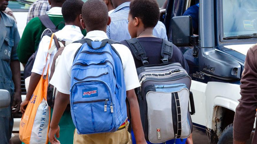 Students at Nyabugogo bus terminal carry their bags, as they headed back to school at the weekend. Heads of schools have been urged to respect the school calendar as the new academ....