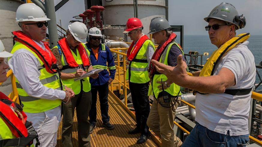 ContourGlobal engineers inspect KivuWatt Methane Gas plant installations on Lake Kivu last year. Rwanda will begin search for petroleum on the lake in March.  File