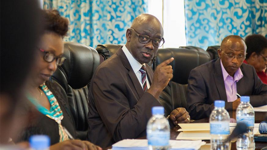 Minister Busingye (C) explains the issue of litigations involving dismissed public servants in Parliament yesterday. / Nadege Imbabazi