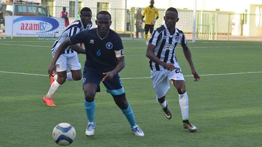 Police FC captain Fabrice Twagizimana goes for the ball against APR's Issa Bigirimana during a recent league match.
